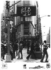 Early promotional picture with the bands name up on lights in Times Square.