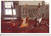 Jeff's guitars at the time.  A Les Paul Jr, his custom explorer, and a Gibson Firebird all lined up and ready for work
