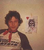Dan Hartman himself.  The picture in the background was started by Jeff during the seesions.  On a almost daily basis, things kept being added to the sketch to turn it into the fine artwork you see before you.  Art has many forms.  Rock and Roll.