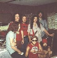 Classic day at Hell House with Allen Collins, Billy Powell, Ronnie VanZant, Gary Rossington, Jeff Carlisi, seated, Leon Wilkerson and Artimus Pyle.  Notice the pistol in the front of Ronnie's jeans.