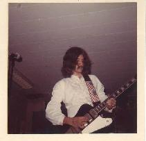 Me and my 1963 Gibson Firebird VII.  This picture was from a gig in Atlanta while I was at Georgia Tech.  The band was Plasma, soon to be Cloud.  Hey, it was the times!